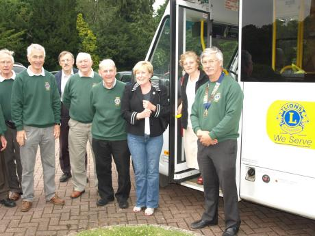 Tring Lions Standing outside the newly painted bus.