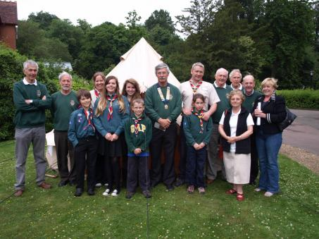The Lions and the Scouts in front of one of the tents